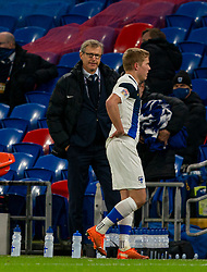 CARDIFF, WALES - Wednesday, November 18, 2020: Finland's Jere Uronen looks dejected as he walks past head coach Markku Kanerva after being sent off during the UEFA Nations League Group Stage League B Group 4 match between Wales and Finland at the Cardiff City Stadium. Wales won 3-1 and finished top of Group 4, winning promotion to League A. (Pic by David Rawcliffe/Propaganda)