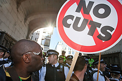 © Licensed to London News Pictures. 15/10/2011. London, UK. 1000s of protesters, angry at cuts and the banks,try to access Paternoster Square, next to the London Stock Exchange. Police on foot and on horseback hold them back. Photo credit : Joel Goodman/LNP