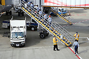 cleaning crew entering a passenger airplane at Narita International airport Tokyo Japan