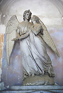 Picture and image of the stone sculpture of 2 angels by  sculptor  F Fabiani 1872. The monumental tombs of the Staglieno Monumental Cemetery, Genoa, Italy .<br /> <br /> Visit our ITALY PHOTO COLLECTION for more   photos of Italy to download or buy as prints https://funkystock.photoshelter.com/gallery-collection/2b-Pictures-Images-of-Italy-Photos-of-Italian-Historic-Landmark-Sites/C0000qxA2zGFjd_k<br /> If you prefer to buy from our ALAMY PHOTO LIBRARY  Collection visit : https://www.alamy.com/portfolio/paul-williams-funkystock/camposanto-di-staglieno-cemetery-genoa.html