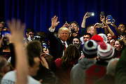 Republican U.S. presidential candidate Donald Trump waves to the crowd on the way to the stage at a campaign town hall event in Wausau, Wisconsin April 2, 2016.   REUTERS/Ben Brewer