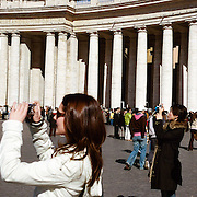 A Panoramic view of tourists taking photographs in front of St. Peter's Colonnade in St.Peter's Square, Vatican City, Rome, Italy. 23rd July 2011. Photo Tim Clayton