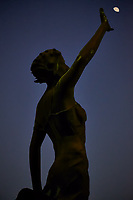 Statue holding back Venus as we dock in Yokohama (and yes, it is Venus -- not the moon). On the upper forward deck of the MV World Odyssey. Semester at Sea, Spring 2016 Voyage -- Day 19. Image taken with a Fuji X-T1 camera and 55-200 mm OIS lens (ISO 1600, 200 mm, f/4.8, 1/30 sec).