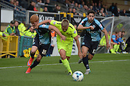 Nicky Featherstone of Hartlepool United (c) tries to go past Ryan Sellers of Wycombe Wanderers (l) and Max Kretzschmar of Wycombe Wanderers (r). Skybet football league two match, Wycombe Wanderers v Hartlepool Utd at Adams Park in High Wycombe, Bucks on Saturday 5th Sept 2015.<br /> pic by John Patrick Fletcher, Andrew Orchard sports photography.