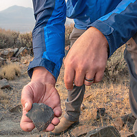 Archaeologists investigate artifacts at an early Native American settlement in the White Mountains of California,