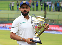 August 14, 2017 - Colombo, Sri Lanka - Indian cricket captain Virat Kohli poses with the winners trophy after the 3rd Day's play in the 3rd and final Test match between Sri Lanka and India at the Pallekele international cricket stadium at Kandy, Sri Lanka on MOnday 14 August 2017. (Credit Image: © Tharaka Basnayaka/NurPhoto via ZUMA Press)