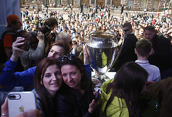 April 21, 2018 - Kiev, Ukraine - Ukrainians take pictures of the UEFA Champions League trophy at the hand over ceremony in Kiev, Ukraine, 21 April, 2018. The Champions League Final is to take place on May 26 at the Olympiyski stadium in Kiev. (Credit Image: © Str/NurPhoto via ZUMA Press)