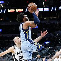 04 April 2017: Memphis Grizzlies guard Mike Conley (11) goes for the jump shot past San Antonio Spurs guard Manu Ginobili (20) and San Antonio Spurs center Pau Gasol (16) during the San Antonio Spurs 95-89 OT victory over the Memphis Grizzlies, at the AT&T Center, San Antonio, Texas, USA.