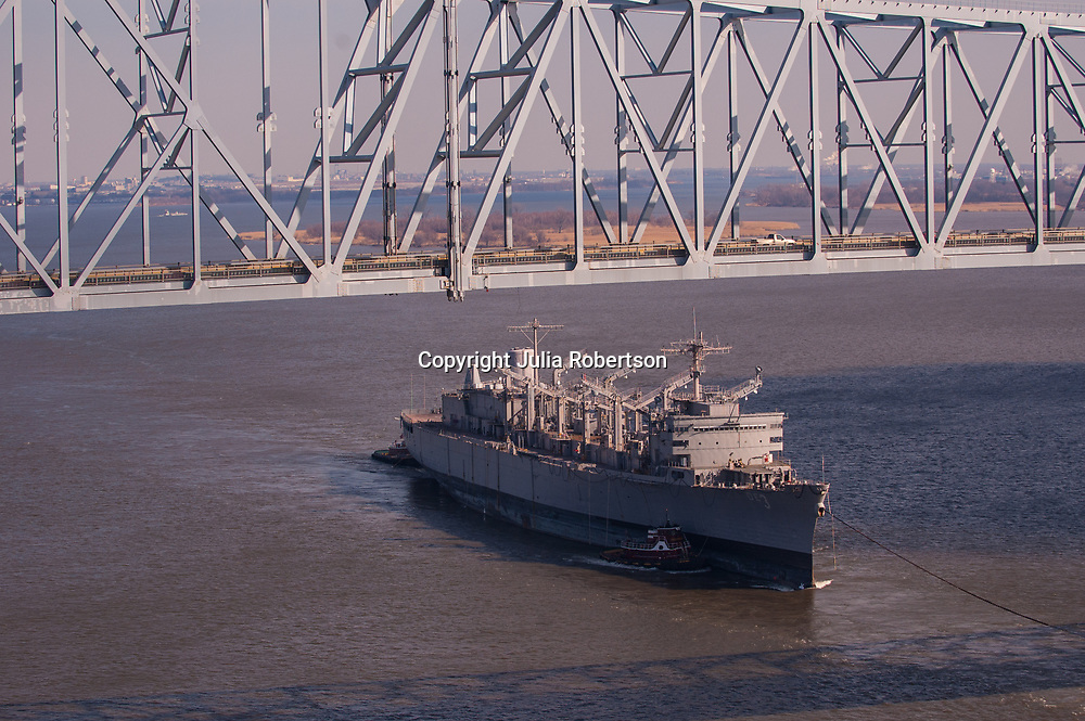 Aerial view of the USS Seattle (AOE-3) being pulled down the delaware river starting trip to seattle for dismantlement into a museum