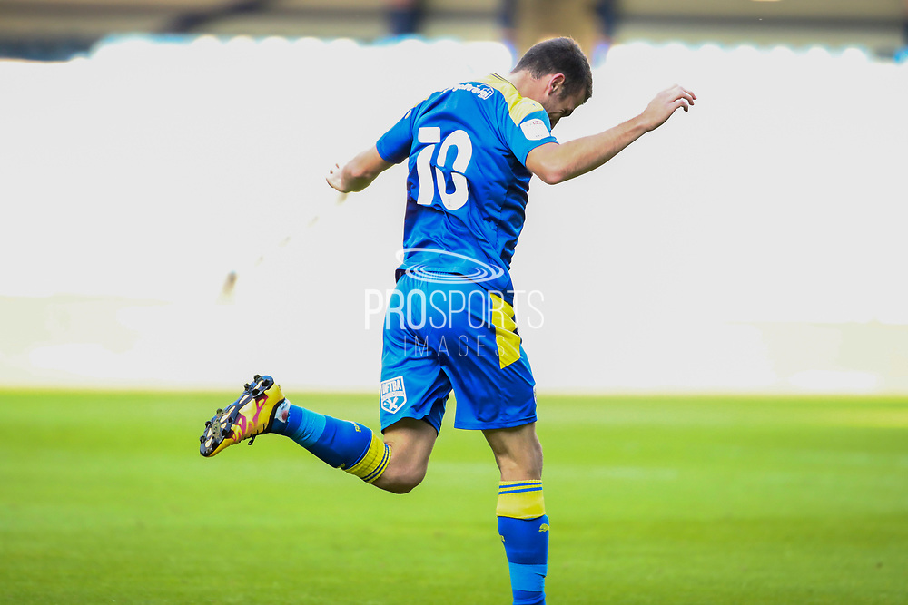 AFC Wimbledon attacker Adam Roscrow (10) celebrating after scoring goal to make it 1-1 during the EFL Trophy Group O match between AFC Wimbledon and Charlton Athletic at the Kiyan Prince Foundation Stadium, London, England on 1 September 2020.