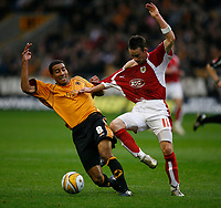 Photo: Steve Bond/Sportsbeat Images.<br /> Wolverhampton Wanderers v Bristol City. Coca Cola Championship. 03/11/2007. Karl Henry (L) grabs the shirt of Michael McIndoe (R)