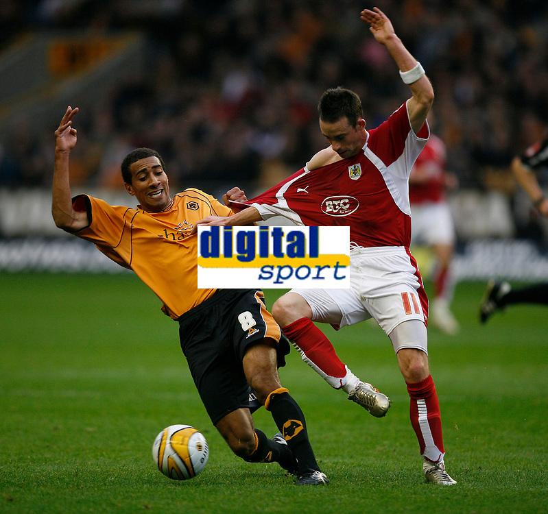 Photo: Steve Bond/Sportsbeat Images.<br /> Wolverhampton Wanderers v Bristol City. Coca Cola Championship. 03/11/2007. Karl Henry (L) grabs the shirt of Michael McIndoe (R)