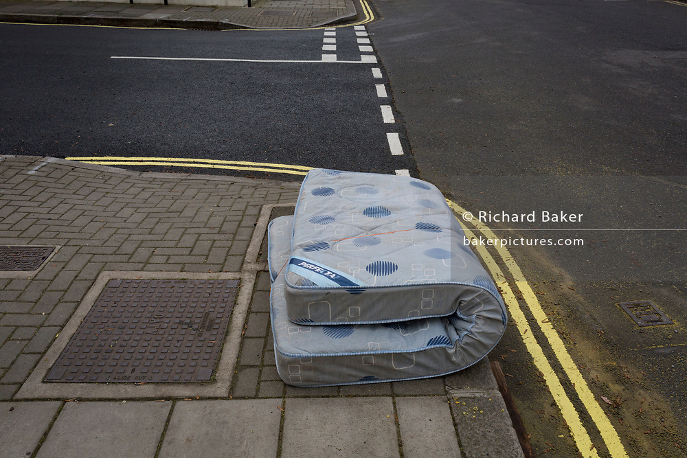 An abandoned mattress lies tied up on a residential street corner in the borough of Lambeth, on 4th December 2017, in London England.