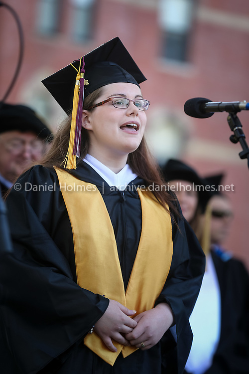 """(5/9/15, FRANKLIN, MA) Graduate Kelsey Ann Taylor sings """"The Star-Spangled Banner"""" during commencement at Dean College in Franklin on Saturday. Daily News and Wicked Local Photo/Dan Holmes"""