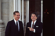President Ronald Reagan points to Vice President Bush in January 1985 at the North Postico of the White House.  (Note: At that time the white wash of the side of the building had been removed for restoration.  ..Photograph by Dennis Brack BBBs 20