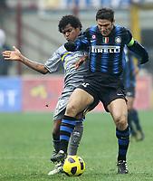 """javier zanetti (inter) angelo (parma)<br /> Milano 28/11/2010 Stadio """"Giuseppe Meazza""""<br /> Campionato Italiano Serie A 2010/2011<br /> Inter vs Parma<br /> Foto Luca Pagliaricci Insidefoto"""
