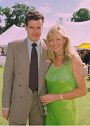 MR PETER BUTLER and his fiance MISS ANNABELLE HESELTINE daughter of Michael Heseltine the former Conservative Deputy Prime Minister, at a polo match in Sussex on 19th July 1998.MJD 93