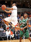 Nov. 15, 2010; Charlottesville, VA, USA; Virginia Cavaliers guard Jontel Evans (1) shoots over USC Upstate Spartans guard Marquis Sloan (11) during the game at the John Paul Jones Arena. Virginia won 74-54. Mandatory Credit: Andrew Shurtleff