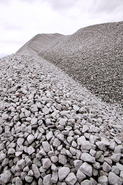Pile of rocks to be used in lower layers of enclosed sanitary landfill