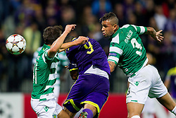 Marcos Tavares of Maribor between Cédric Doubtful of Sporting and Maurício of Sporting during football match between NK Maribor and Sporting Lisbon (POR) in Group G of Group Stage of UEFA Champions League 2014/15, on September 17, 2014 in Stadium Ljudski vrt, Maribor, Slovenia. Photo by Vid Ponikvar  / Sportida.com
