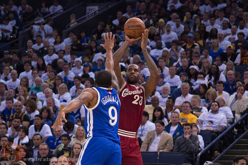 December 25, 2015; Oakland, CA, USA; Cleveland Cavaliers forward LeBron James (23) shoots the basketball against Golden State Warriors forward Andre Iguodala (9) during the second quarter in a NBA basketball game on Christmas at Oracle Arena. The Warriors defeated the Cavaliers 89-83.
