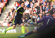 Mersut Ozil of Arsenal scores his teams 2nd goal . Premier league match, Stoke City v Arsenal at the Bet365 Stadium in Stoke on Trent, Staffs on Saturday 13th May 2017.<br /> pic by Bradley Collyer, Andrew Orchard sports photography.