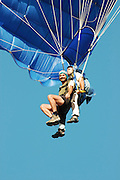 Israel, Mediterranean coast paragliding Instructor and trainee tied together during the jump