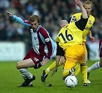 Photo Aidan Ellis.<br /> Scunthorpe United v Lincoln City <br /> Division Three Play Off Semi Final (2nd Leg). 14/05/03.<br /> Scunthorpe's Paul Dalglish tuens Lincoln's Stuart Bimson