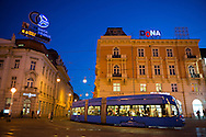 A tram makes a turn in the hour after sunset in central Zagreb, Croatia