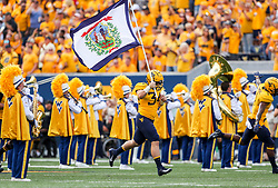 Sep 14, 2019; Morgantown, WV, USA; West Virginia Mountaineers linebacker Shea Campbell (34) leads the team onto the field before their game against the North Carolina State Wolfpack at Mountaineer Field at Milan Puskar Stadium. Mandatory Credit: Ben Queen-USA TODAY Sports