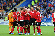 Cardiff city's Peter Whittingham © celebrates with teammates after he scores his sides 3rd goal (his 3rd).  NPower championship, Cardiff city v Wolverhampton Wanderers at the Cardiff city stadium in Cardiff, South Wales on Sunday 2nd Sept 2012. pic by Andrew Orchard, Andrew Orchard sports photography,