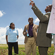 Senior UNDP staff share a joke with a representative of their in the fields at Giwa Resettlement Farm near Nakuru in Kenya's Rift Valley Province.