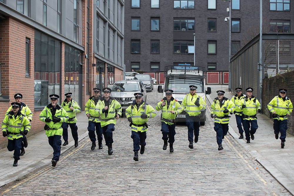 © Licensed to London News Pictures . 07/04/2018. Manchester, UK. Police move to contain a group of fans chanting Manchester City slogans in Manchester's Northern Quarter , ahead of the Manchester City vs Manchester United derby match. If they win the match, Manchester City will win the League title. Photo credit : Joel Goodman/LNP