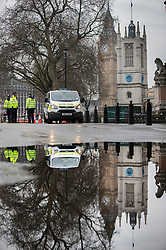 © Licensed to London News Pictures.23/03/2017.London, UK. Police man a cordon near Parliament Square in Westminster, London, the day after a lone terrorist killed 4 people and injured several more, in an attack using a car and a knife. The attacker managed to gain entry to the grounds of the Houses of Parliament, killing one police officer.Photo credit: Peter Macdiarmid/LNP