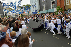 © Licensed to London News Pictures. 01/05/2017 May Day celebrations in Padstow Cornwall.The Bluer Oss.  The Blue Oss and the Red Osds lead the traditional May Day celebrations around the historic harbour of Padstow in Cornwall.<br /> Despite the rain large crowds attended the annual event.Photo credit : MARK HEMSWORTH/LNP