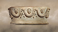 """Picture of Roman relief sculpted Sarcophagus of Garlands, 2nd century AD, Perge. This type of sarcophagus is described as a """"Pamphylia Type Sarcophagus"""". It is known that these sarcophagi garlanded tombs originated in Perge and manufactured in the sculptural workshops of Perge. Antalya Archaeology Museum, Turkey.. Against a warm art background..<br /> <br /> If you prefer to buy from our ALAMY STOCK LIBRARY page at https://www.alamy.com/portfolio/paul-williams-funkystock/greco-roman-sculptures.html . Type -    Antalya    - into LOWER SEARCH WITHIN GALLERY box - Refine search by adding a subject, place, background colour, etc.<br /> <br /> Visit our ROMAN WORLD PHOTO COLLECTIONS for more photos to download or buy as wall art prints https://funkystock.photoshelter.com/gallery-collection/The-Romans-Art-Artefacts-Antiquities-Historic-Sites-Pictures-Images/C0000r2uLJJo9_s0"""