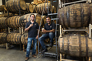 Virag Saksena (left) and Vishal Gauri pose for a portrait at 10th Street Distillery in San Jose, California, on September 4, 2019. (Stan Olszewski for Content Magazine)