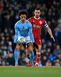 Bailey Wright of Bristol City battles for the ball with  Leroy Sane of Manchester City  - Mandatory by-line: Matt McNulty/JMP - 09/01/2018 - FOOTBALL - Etihad Stadium - Manchester, England - Manchester City v Bristol City - Carabao Cup Semi-Final First Leg