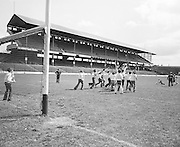 Children take turns hitting the slitor towards the goal as others attempt to block it during their visit to Croke Park during a Kells Educational Tour on the 25th June 1976.