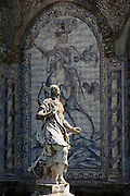 Statues and old azulejos, the iconic blue-glazed ceramic tile work from the area, in the beautiful gardens of the Palacio de Fronteira, in Lisbon, Portugal