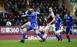 Burnley's Peter Crouch (left) and Leicester City's Christian Fuchs battle for the ball during the Premier League match at Turf Moor, Burnley.