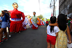 November 18, 2018 - Philippines - Higantes (Giant) effigy marches on the streets town of Angono province of Rizal on November 18, 2018. Higantes (Giant) Festival is celebrated November in the city of Angono, Province of Rizal in the Philippines to honor San Clemente, the patron saint of fishermen. The festival features a parade of hundreds of higantes, papier-mâché giants. Higantes (Giant) are puppets rendered as man or woman in various costumes; their face gives a commanding look, their hands on the waist. (Credit Image: © Gregorio B. Dantes Jr/Pacific Press via ZUMA Wire)