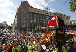May 26, 2019 - Kiev, Ukraine - Devotees of the Hare Krishna participate at the festival of Ratha Yatra, or chariot procession in downtown Kiev, Ukraine, on 26 May 2019. Ratha yatra, or Chariot festival, features a huge chariot pulled by hand across the Khreschatyk streets in center of Kiev accompanied by constant singing, chanting, drums, cymbals and dancing. Rathayatra is one of the most important and most colorful holidays in India, and every year in Puri, Orissa, India, more than 500,000 people are celebrating it. (Credit Image: © Serg Glovny/ZUMA Wire)