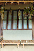 Curing and drying vegetables, herbs, grains in Japan is done simply by hanging them from the rafters in the southernmost part of a farmhouse which gets the most sunshine exposure.  Plums, corn, radishes, persimmons are usually dried and cured in this way.