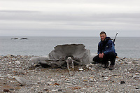Man sitting by an old knuckle, Svalbard