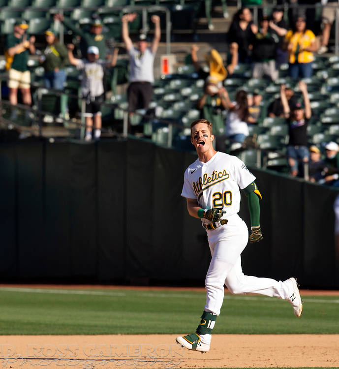 Sep 26, 2021; Oakland, California, USA; Oakland Athletics left fielder Mark Canha (20) reacts after hitting a game-winning single against the Houston Astros in the ninth inning at RingCentral Coliseum. Mandatory Credit: D. Ross Cameron-USA TODAY Sports