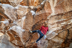 Climber at Hueco Tanks State Park & Historic Site, El Paso, Texas. USA.