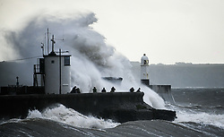 © Licensed to London News Pictures. 21/08/2020. City, UK. Waves crash against the pier at Porthcawl at high tide this morning in south Wales as Storm Ellen hits the UK bringing strong winds, especially to coastal areas.. Photo credit: Robert Melen/LNP