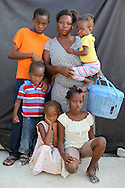 Anise Cange with her childrem in a tent city in Port-au-Prince after the earthquake. She saved basket so she can save food for children but not much else.