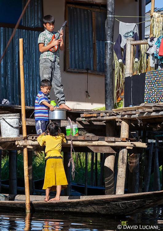 Children playing near their hut.